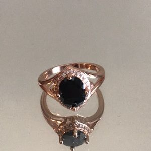 Rose gold and onyx halo ring
